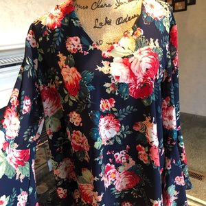 Beautiful floral top with flutter sleeves